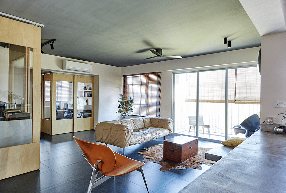 House Tour: $80,000 renovation for this open-plan, multi-purpose HDB home with lots of wood and concrete title=