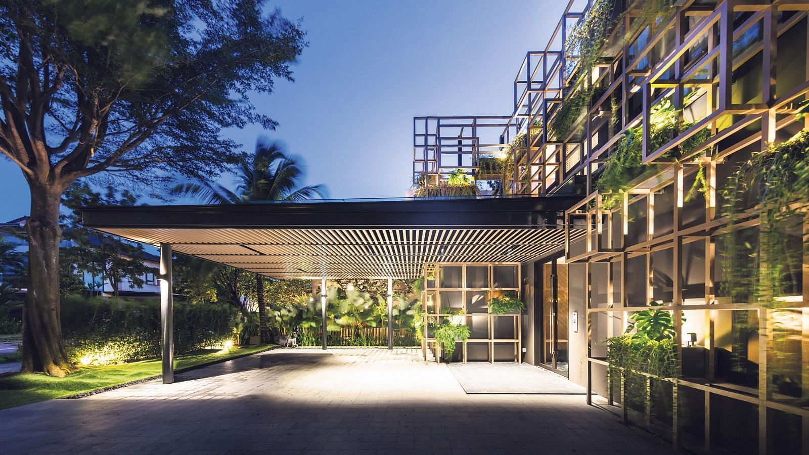 House Tour: Two-storey Sentosa Cove house with a grid-like facade dotted with tropical plants  title=