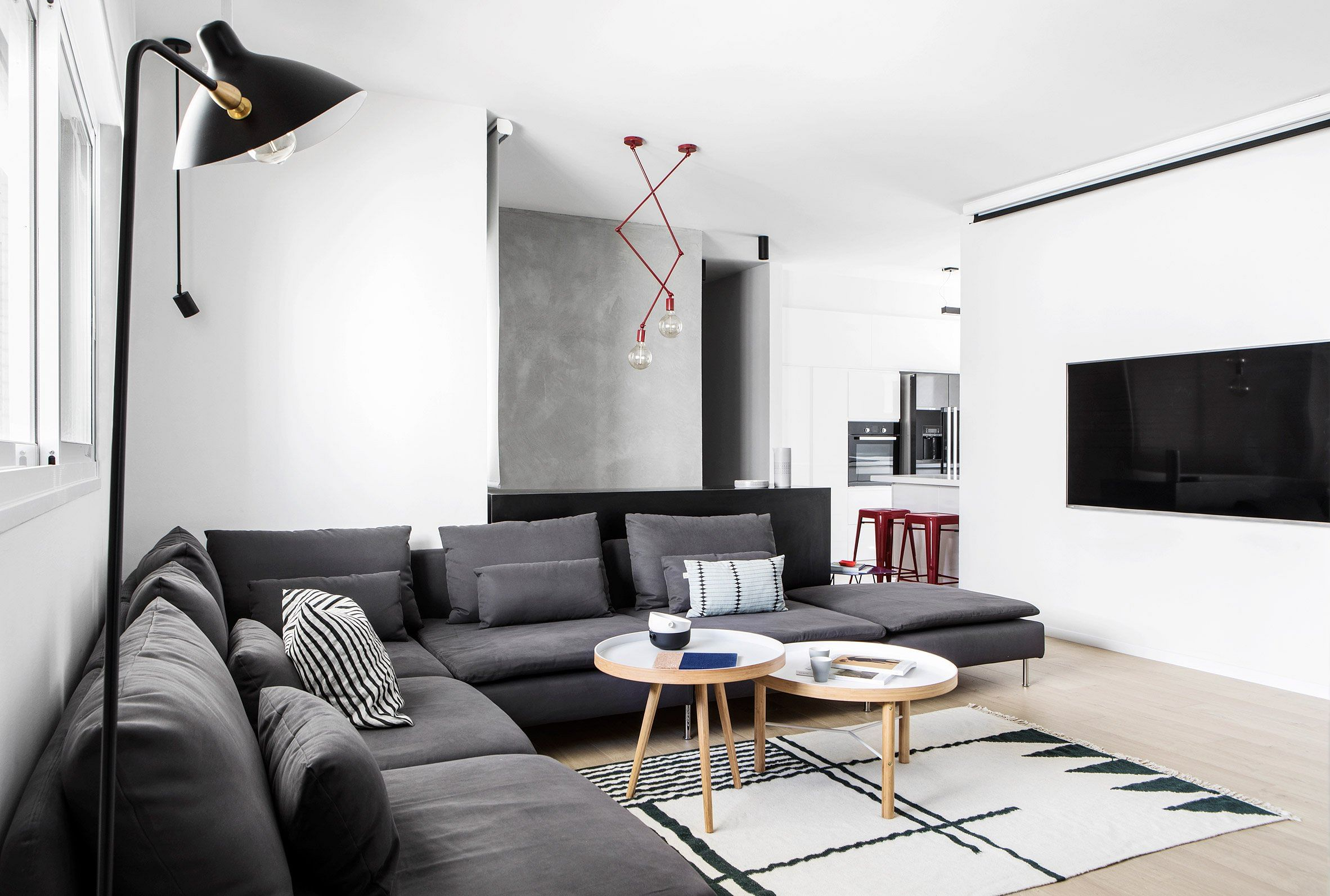 House Tour: A modern 240sqm duplex space featuring muted tones, geometric shapes and an industrial touch title=