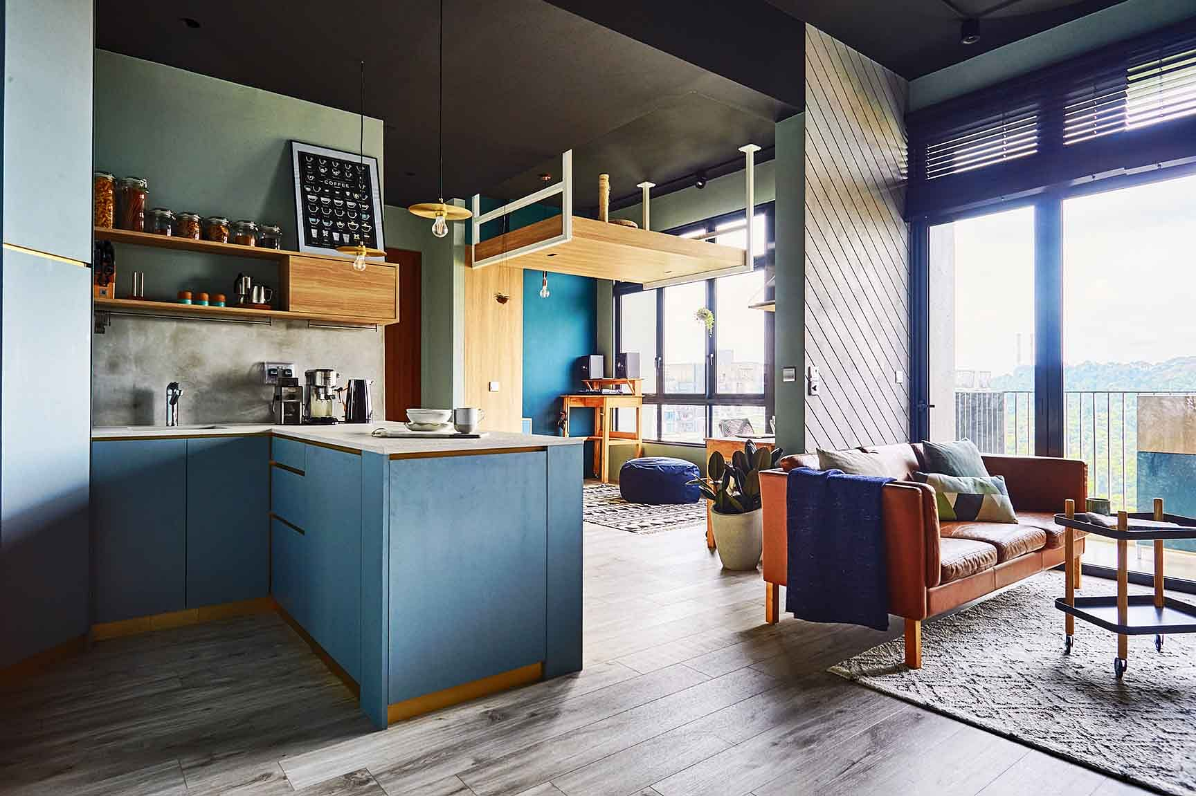 House Tour: A minimalist, Nordic-style two-bedroom condo apartment with green and blue shades title=