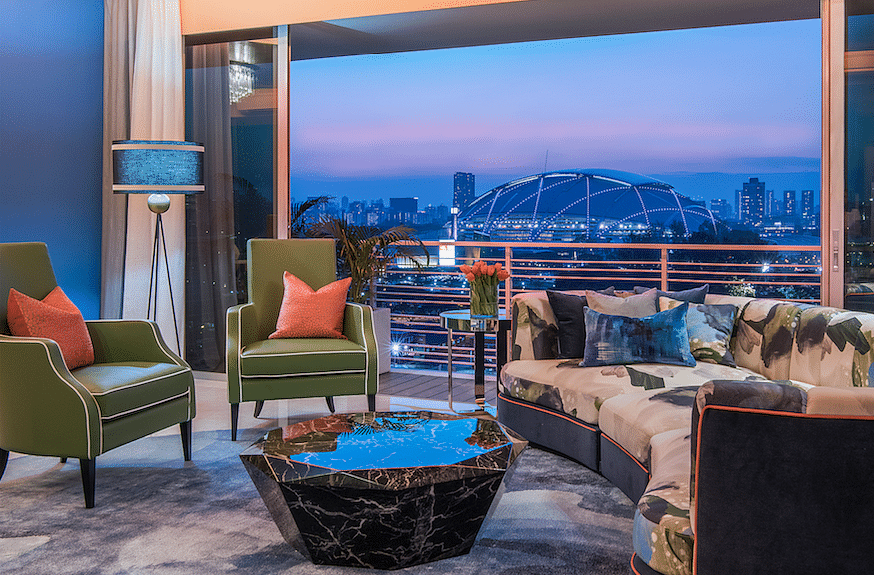 House Tour: This colourful 1,650sqf 3-bedroom apartment in Tanjong Rhu has bespoke furniture that matches its stunning view! title=
