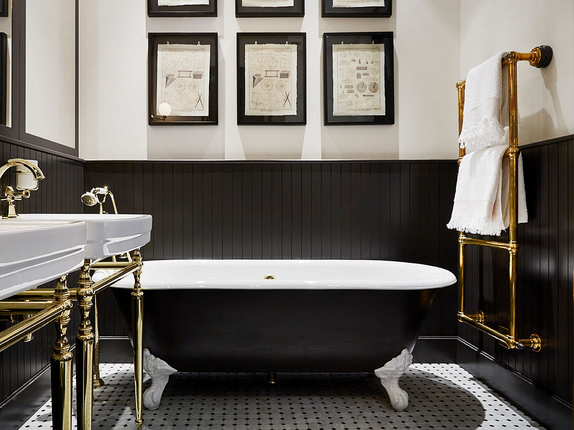 ... We Love The Detailing On The Gold Fixtures, Octagonal Tiled Floor, And  Ornate Bathtub Legs. We Also Appreciate The Clean Lines From The High Black  ...
