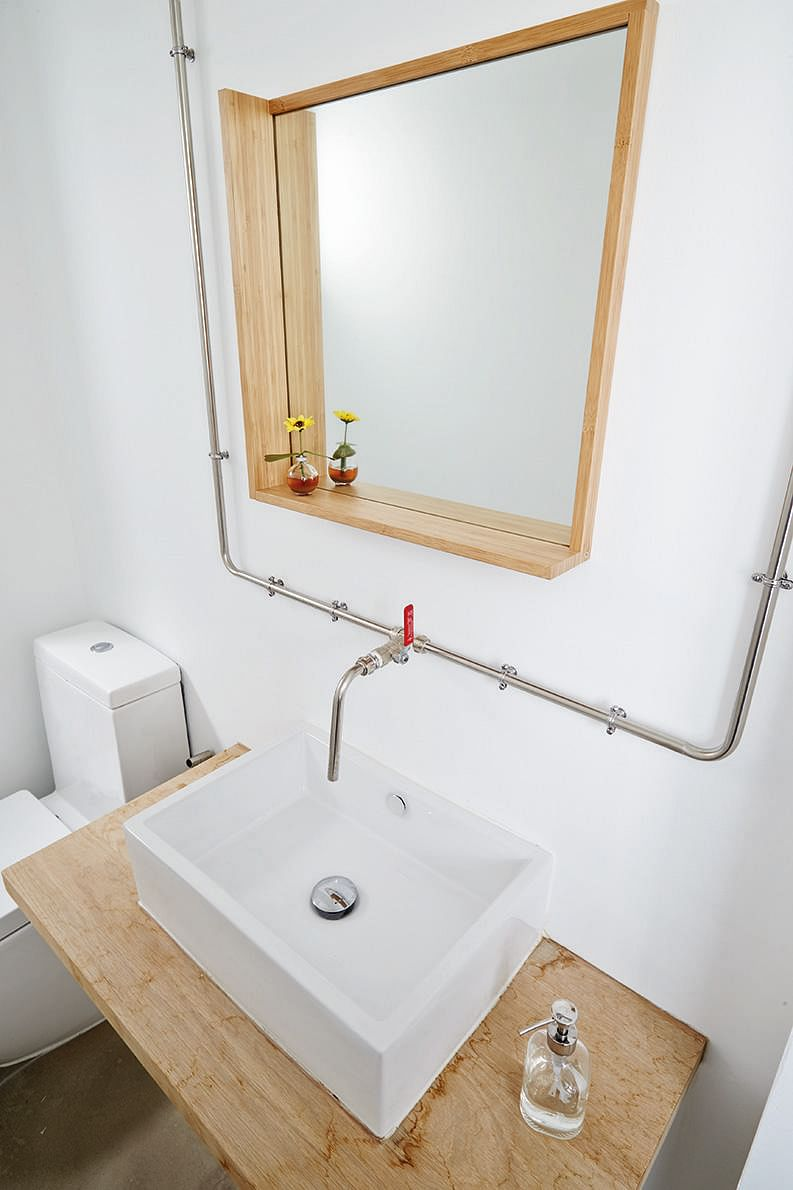 this mirror has a simple l shaped ledge which can hold small items design desmond ong