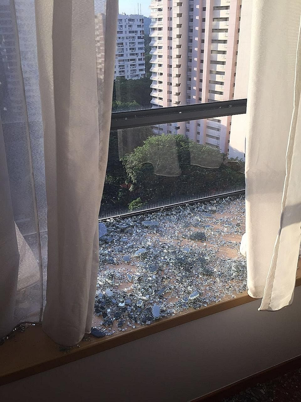 Find Out Why A Window At This Condo Spontaneously