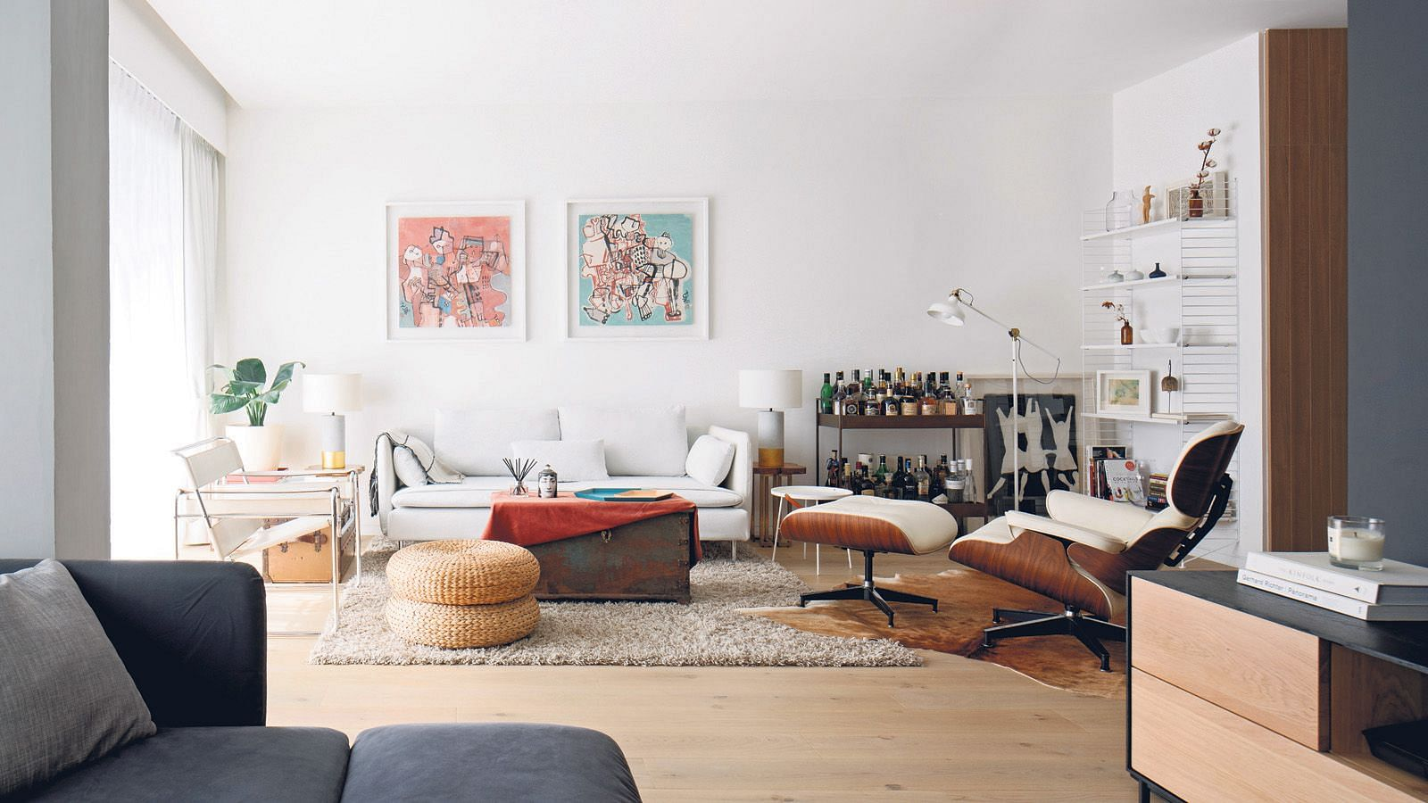 The All White Living Room Is A Bright Spot In The Apartment.