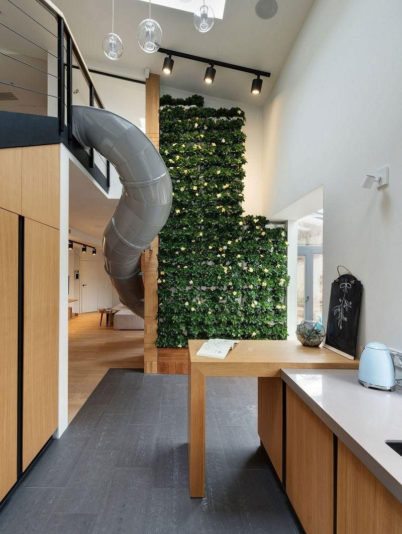 House Tour: A trendy minimalist apartment with a green wall and slide! 2