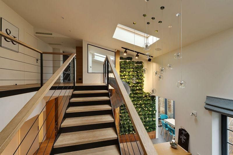 House Tour: A trendy minimalist apartment with a green wall and slide! 8