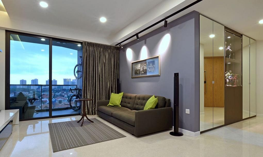 The design team at knq associates completed a new condominium unit near dakota mrt station which is filled with warm colours and contemporary touches