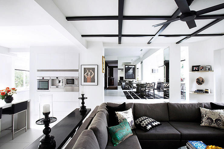 Black Design Features Such As The Grid On Ceiling And Furnishings Charcoal Sofa Stand Out Even More Lots Of Sunlight Helps In Keeping