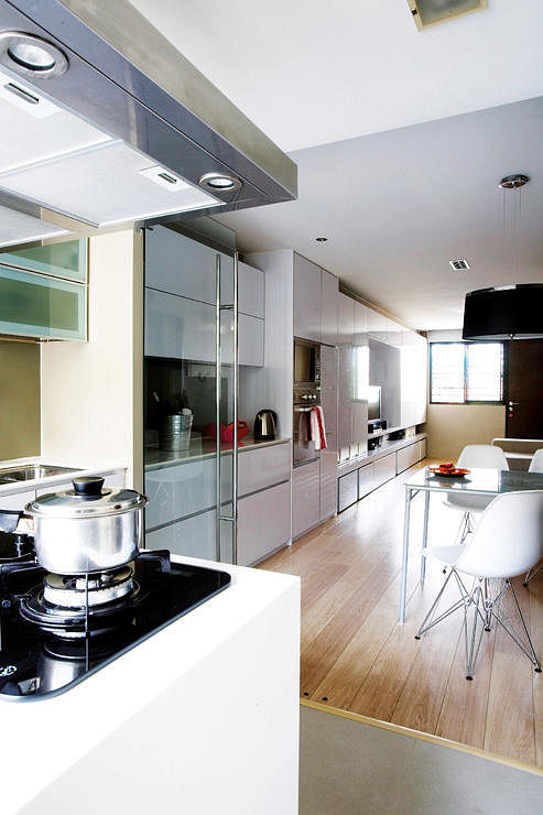 Check out this 3 room flat 39 s stunning white and light wood palette home decor singapore for Hdb wet and dry kitchen design