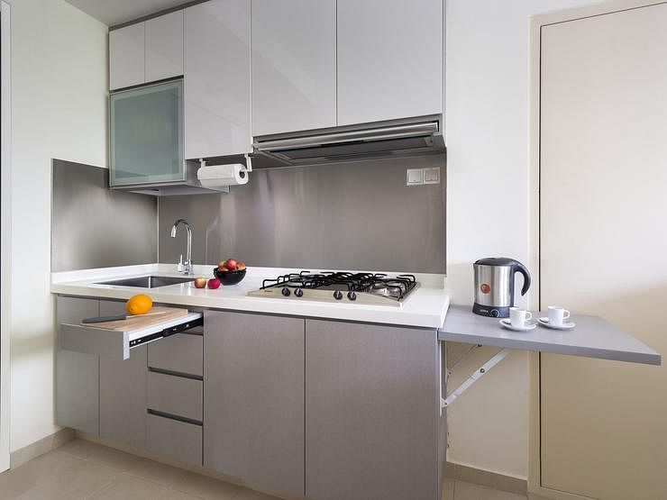 A small condo unit packed with space saving ideas home for Kitchen ideas limited
