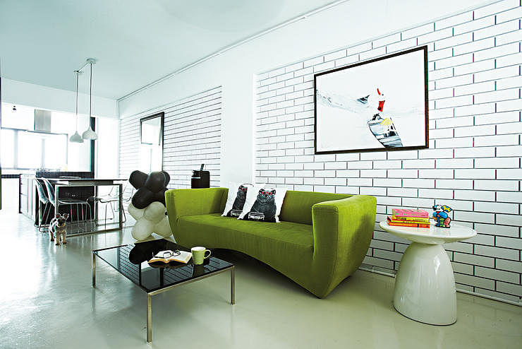 Living Room Green Sofa Coffee Table Brick Wall