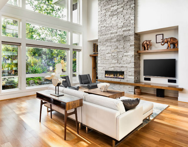 a stylish living room with a white sofa and television