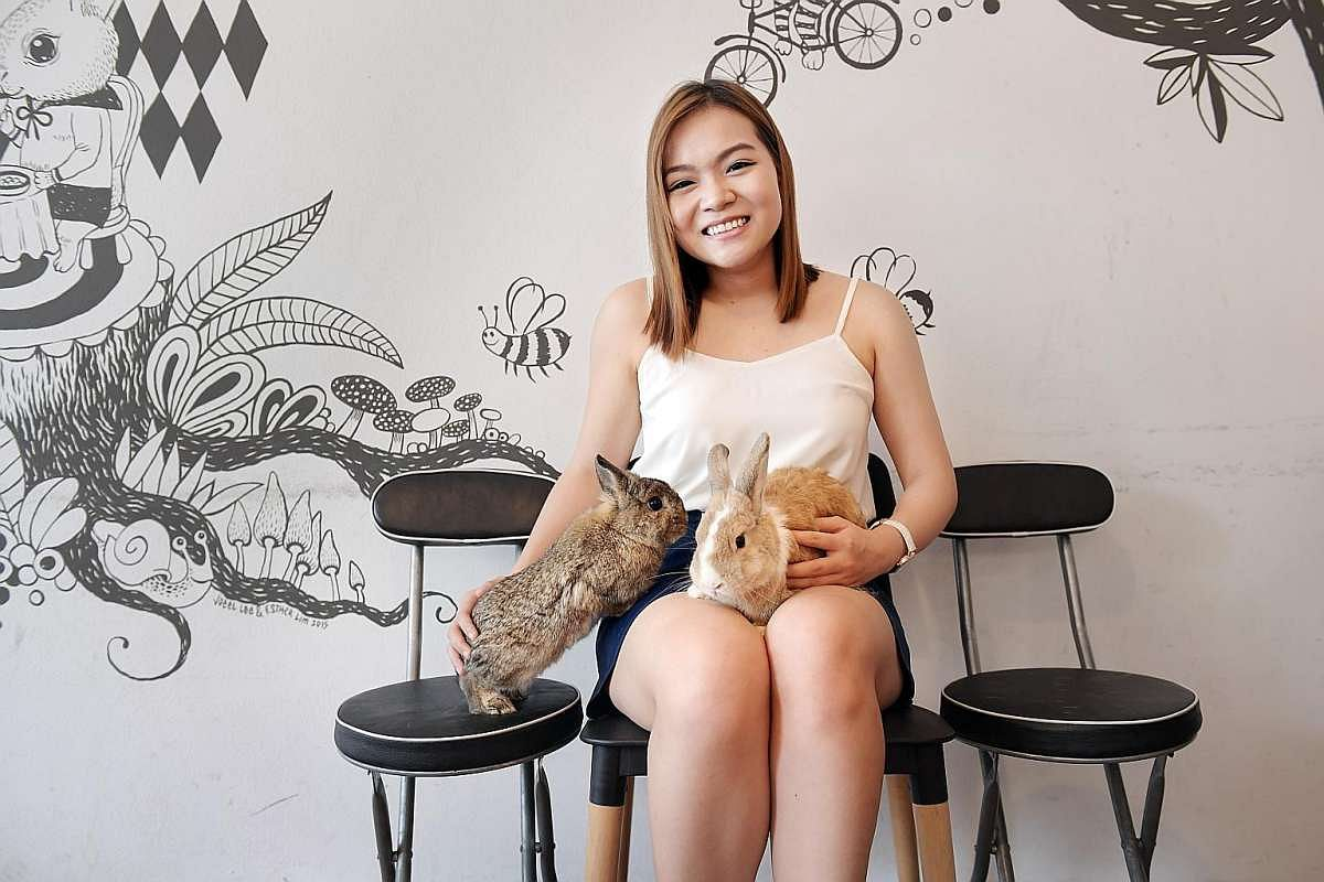 Angel Liew with her pet bunnies, Kiwi (left) and Eskimo.
