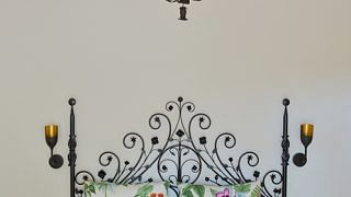 77509-12-each-guest-room-has-different-feel-one-features-wrought-iron-bed-and-colourful-botanical-style-cu