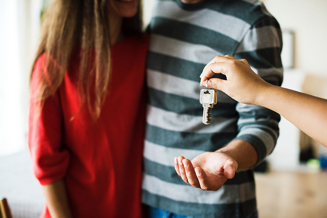 couple getting keys to house