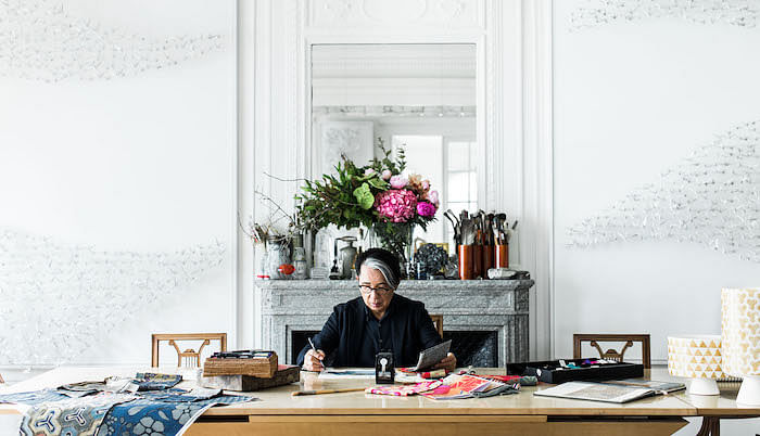 Kenzo Takada at work in his atelier. Image courtesy of Zoe Fidji.