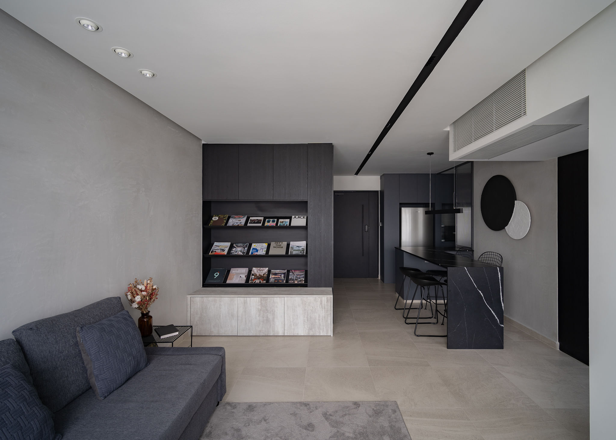 House Tour: A minimalist, dark-hued apartment with